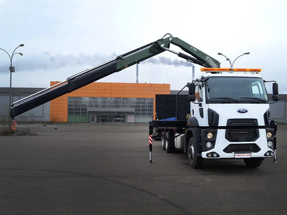 Автоэвакуатор для крупной строительной техники на базе Ford Cargo 2533DC.
