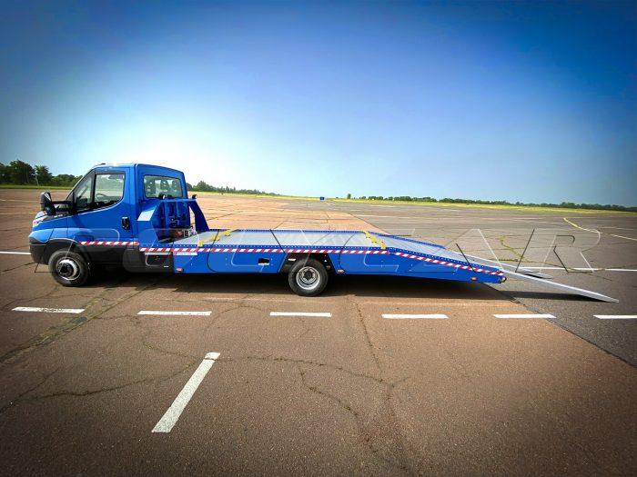 Эвакуаторная платформа Polycar на Iveco Daily 65c15.